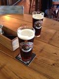 Dos tazas de cerveza Foto de archivo libre de regalías