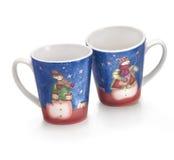 Dos tazas de la Navidad Foto de archivo libre de regalías