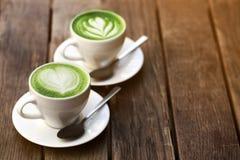 Dos tazas de latte del matcha Fotografía de archivo