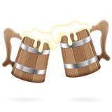 Dos tazas de madera con la cerveza Imagen de archivo libre de regalías