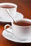 Dos tazas de té con los platillos Foto de archivo libre de regalías