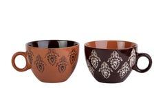 Dos tazas marrones con el modelo Imagen de archivo