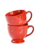 Dos tazas rojas en el fondo blanco imágenes de archivo libres de regalías