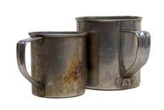 Dos tazas sucias del metal Imagenes de archivo