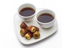 Dos tazas y fechas de café. Fotografía de archivo
