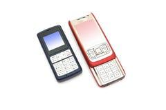 Dos teléfonos celulares Imágenes de archivo libres de regalías