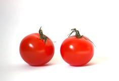 Dos tomates rojos maduros Fotos de archivo libres de regalías