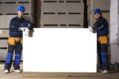 Dos trabajadores de construcción con el vector blanco Fotografía de archivo libre de regalías