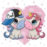Dos unicornios de la historieta en un fondo del corazón stock de ilustración