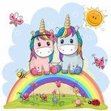 Dos unicornios de la historieta se están sentando en el arco iris stock de ilustración
