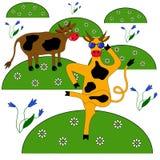 Dos vacas en un prado de flores Foto de archivo