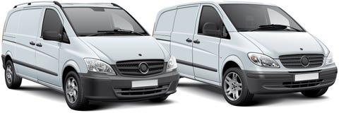 Dos vehículos de las mercancías de la luz blanca Fotos de archivo libres de regalías