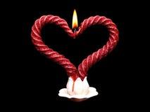 Dos velas ardientes rojas de espiral Fotos de archivo