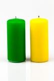 Dos velas de diversos colores Fotos de archivo libres de regalías