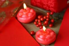 Dos velas rojas de quema Fotografía de archivo