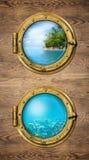 Dos ventanas de la nave con la isla tropical del océano y bajo el agua profundamente fotos de archivo