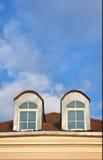 Dos ventanas en ático Fotos de archivo