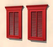 Dos ventanas rojas en luz fuerte del verano Imágenes de archivo libres de regalías