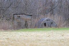 Dos vertientes abandonadas en el bosque Fotos de archivo