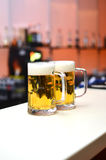 Dos vidrios de cerveza foto de archivo libre de regalías