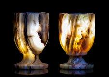 Dos vidrios de piedra brillan intensamente del interior en diversos colores Foto de archivo libre de regalías
