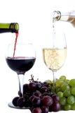 Dos vidrios de vino con las uvas Foto de archivo libre de regalías