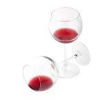 Dos vidrios de vino rojo en el fondo blanco Fotos de archivo libres de regalías