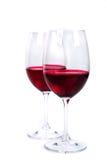 Dos vidrios de vino rojo en un fondo blanco Fotografía de archivo libre de regalías