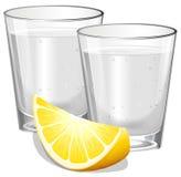 Dos vidrios de vodka con el limón ilustración del vector
