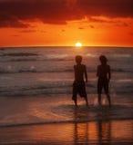 Dos y puesta del sol Foto de archivo libre de regalías