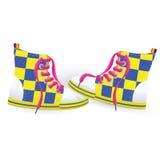 Dos zapatillas de deporte amarillas Fotos de archivo libres de regalías