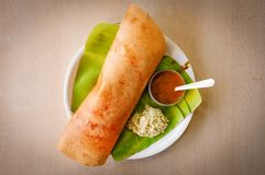 Dosa on banana leaf. Stock Photo