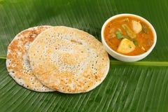 Dosa and sambar On banana leaf Royalty Free Stock Images