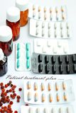 Variety of dosage forms for patient treatment planning. Dosage forms of tablets, dragees, capsules, drops, syrups when planning a treatment plan by a doctor for royalty free stock image