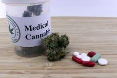 Dosage of medical marijuana and pills royalty free stock photography