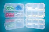 Dosage plastic drugs container Stock Photos