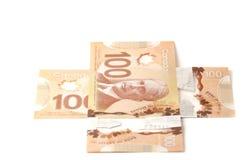 Doscientos billetes de dólar canadienses en un signo más Fotografía de archivo libre de regalías