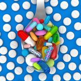 Dose of colorful pills in spoon royalty free stock photos