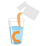 A dose of powder with vitamin C is poured out of the package int Royalty Free Stock Images