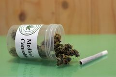 Dose of therapeutic cannabis and a joint stock image