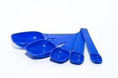 Doseurs bleus d'isolement sur le blanc images stock