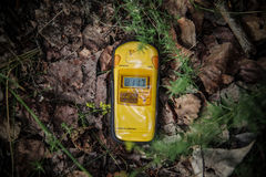 Dosimeter showing high levels of radiation. Description: Dosimeter placed on radioactive ground in Chernobyl zone, showing very high levels of radiation stock photography