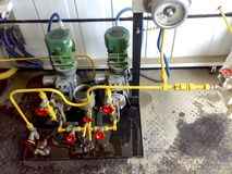 Dosing pumps in reagent block. Chemicals are fed into the system to better delaminate the oil and water emulsion. Dosing pumps in reagent block. Chemicals are royalty free stock photography