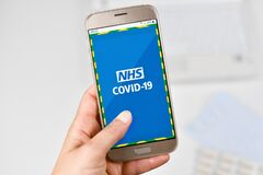`NHS COVID-19` contact tracing app for monitoring the spread of the COVID-19 pandemic in the UK