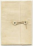 Dossier antique avec la fermeture de ficelle image libre de droits