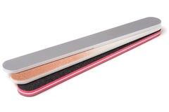 Dossier de clou trois avec un abrasif différent d'isolement sur le fond blanc Image stock