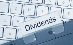 Dossier de dividendes sur le clavier d'ordinateur Images libres de droits