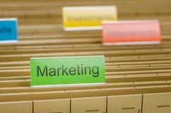 Dossieromslag met Marketing wordt geëtiketteerd die Royalty-vrije Stock Foto's