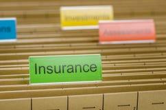 Dossieromslag met Verzekering wordt geëtiketteerd die Stock Foto's