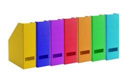 Dossiers colorés de bureau d'isolement sur le blanc Photos libres de droits